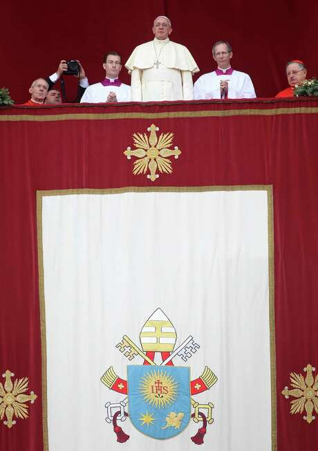 In his Christmas Day address from the central balcony of St. Peter's Basilica, Pope Francis even gave a nod to atheists. Photo: Franco Origlia / Getty Images / 2013 Getty Images