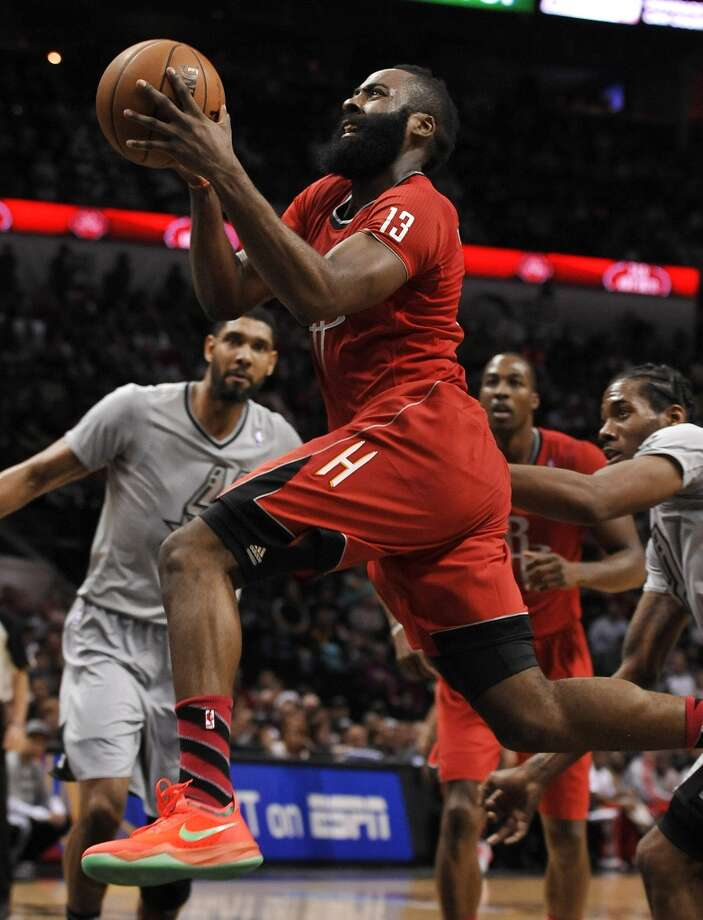 James Harden shoots ahead of Spurs forward Kawhi Leonard, right, during the second half. Photo: Darren Abate, Associated Press