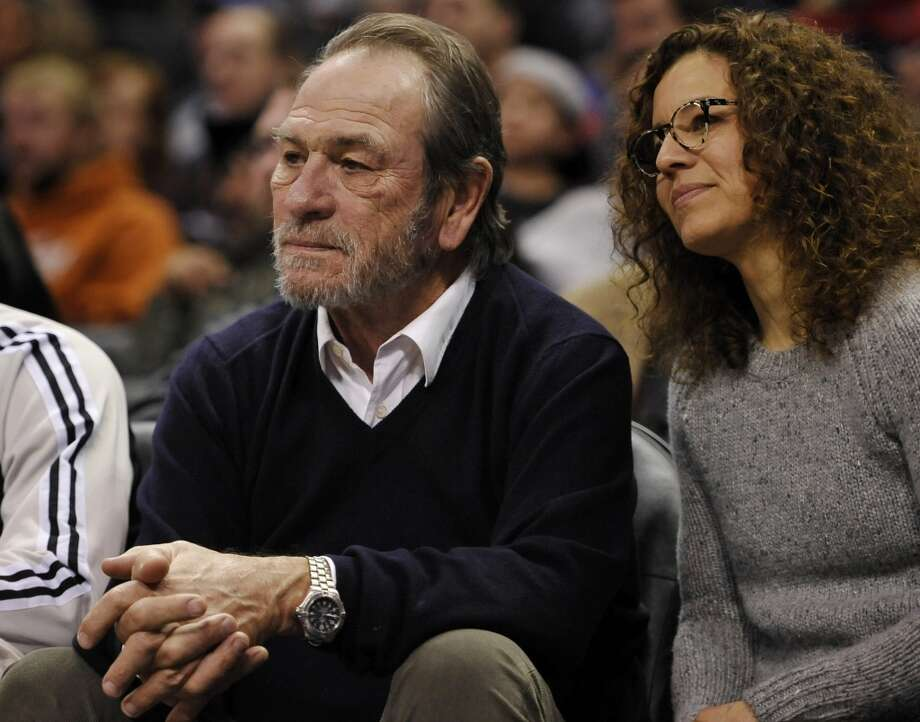Actor Tommy Lee Jones, left, and his wife, Dawn Laurel-Jones, watch play during the second half . Photo: Darren Abate, Associated Press