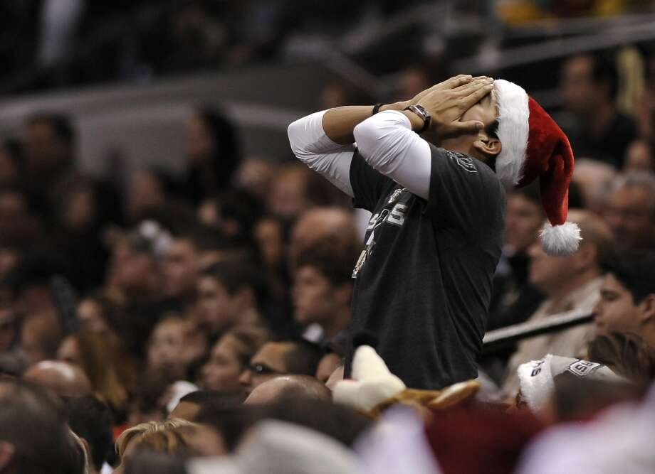 A Spurs fan reacts to a call during the second half. Photo: Darren Abate, Associated Press