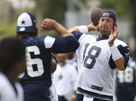 Signs increasingly are pointing toward Kyle Orton (right) starting under center Sunday as Dallas' Tony Romo deals with a back ailment. Photo: Kin Man Hui / San Antonio Express-News / ©2013 San Antonio Express-News
