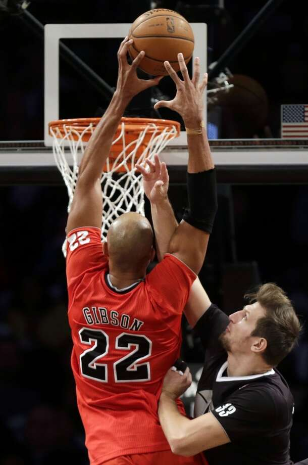 Bulls 95, Nets 78Bulls forward Taj Gibson slams home two of his game-high 20 points. Gibson also had eight rebounds in 28 minutes off the bench. Photo: Seth Wenig, Associated Press