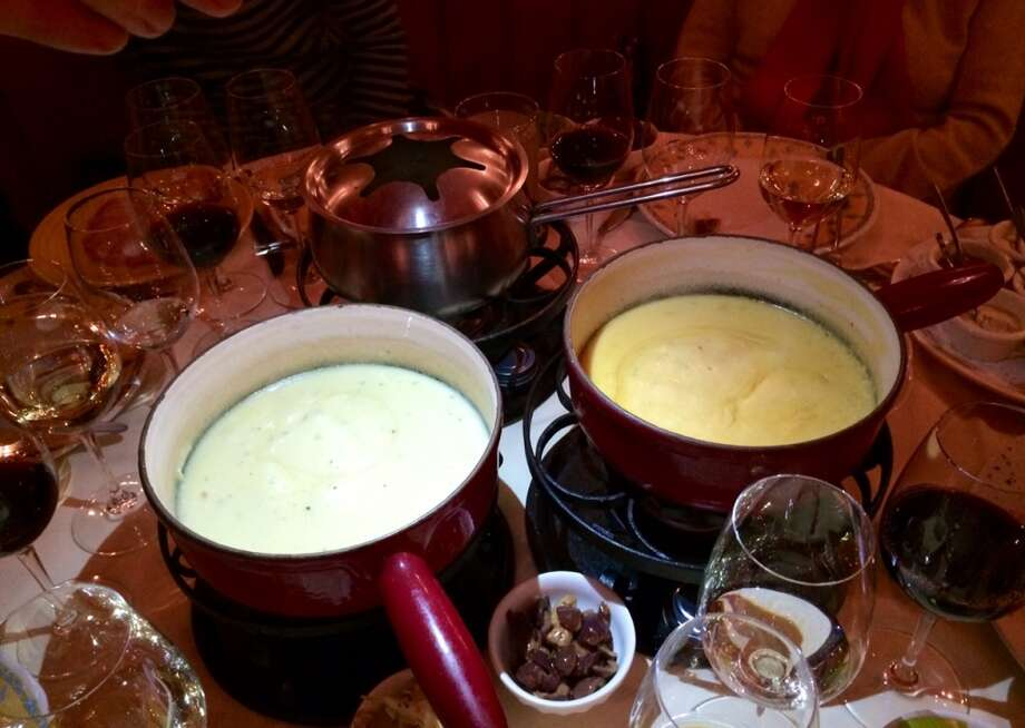 The half and half and the smoky cheese fondues ($41.50 for 2 persons)