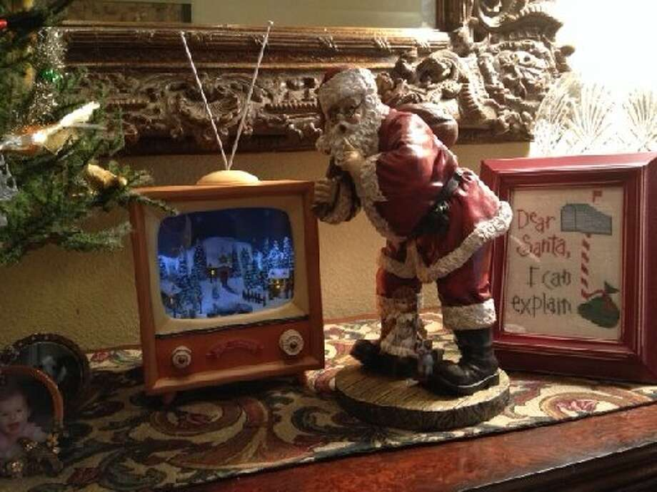 "Diane Simpson: ""This music box TV is a hit with everyone. The Santa, who seems to be saying shh, is perfect along with a cross-stitch I did that says, 'Dear Santa, I can explain.' "" Photo: Courtesy Photo"