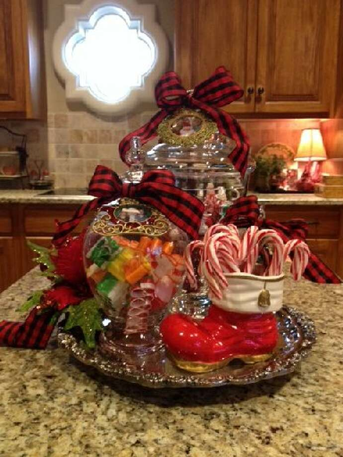 "Diane Simpson: ""My grandchildren, and 'big kids,' too, love the candy jars on the silver tray. The Santa boot is from the 1960s. On each jar is a tiny picture of my grandchildren with Santa in a Christmas frame."" Photo: Courtesy Photo"