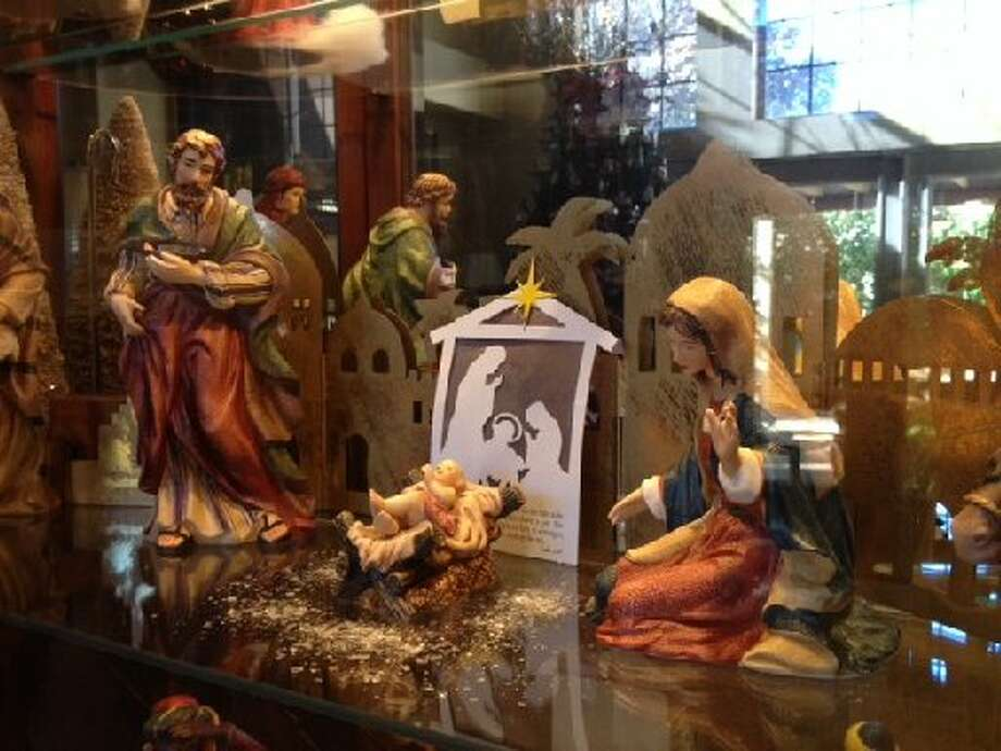 "Diane Simpson: ""Our nativity is in a curio cabinet. The set is porcelain and we bought it at, of all places, Sam's when we first moved here in 1992. Every detail on the figures is beautiful ... as it should be."" Photo: Courtesy Photo"