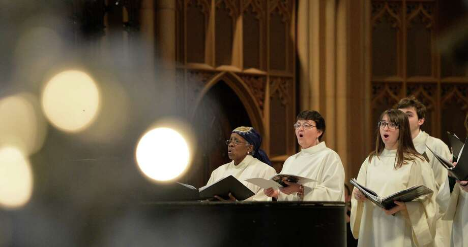The choir sings Christmas Choirs at the start of the 11 a.m. Mass Wednesday Dec. 25, 2013,  at the Cathedral of the Immaculate Conception in Albany, N.Y.   (Skip Dickstein / Times Union) Photo: SKIP DICKSTEIN / 00025145A