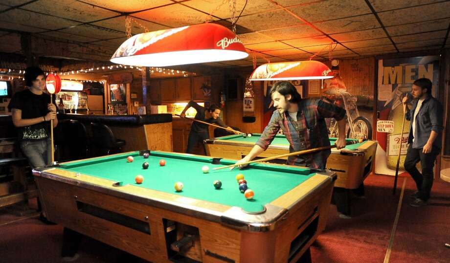 Barely Blind plays a few games of pool at The Riverside Tavern in Port Neches, Tuesday. Tammy McKinley/The Enterprise