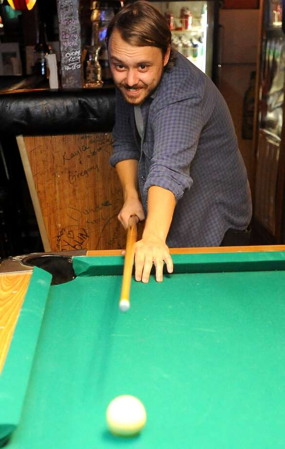 Will Smith of Barely Blind plays pool at The Riverside Tavern in Port Neches, Tuesday. Tammy McKinley/The Enterprise