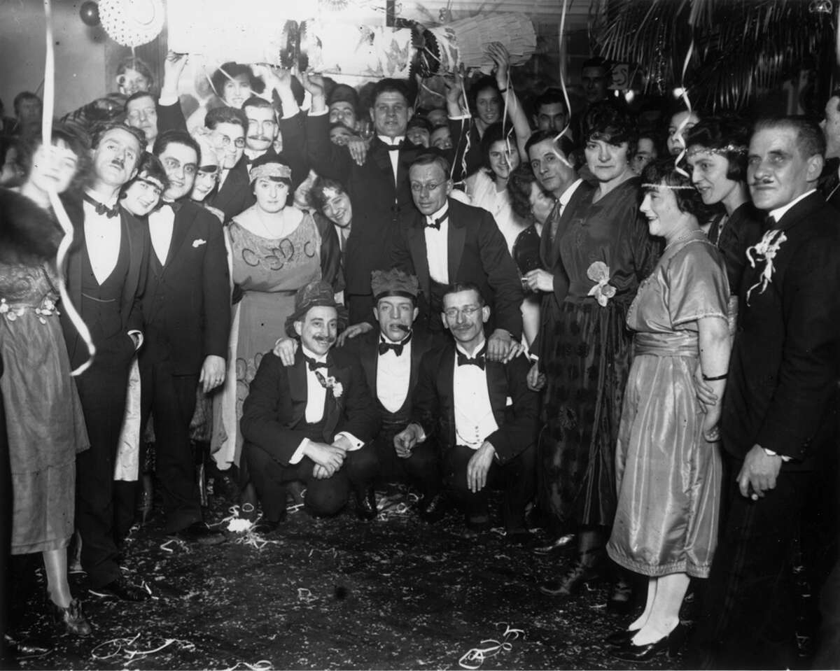 New Year's Eve revelers at the Sporting Club stop the party momentarily to record the event for posterity on Jan. 1, 1922.
