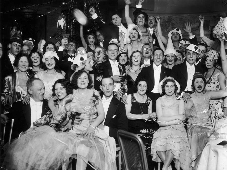 A New Year's Eve party at Deauville Restaurant, Regent Street in London on Jan. 1, 1930. Photo: J. A. Hampton, Getty Images / Hulton Archive