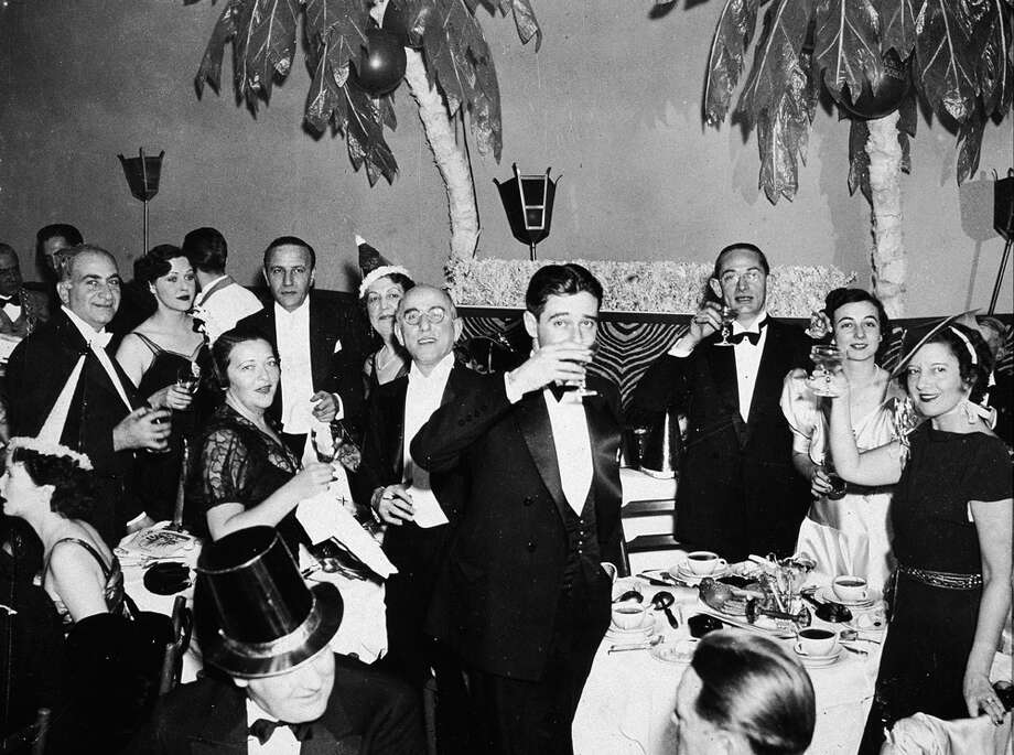 A group of people in formal attire celebrate on New Year's Eve at the El Morroco night club in New York City, circa 1935. Photo: Hulton Archive, Getty Images / 2003 Getty Images
