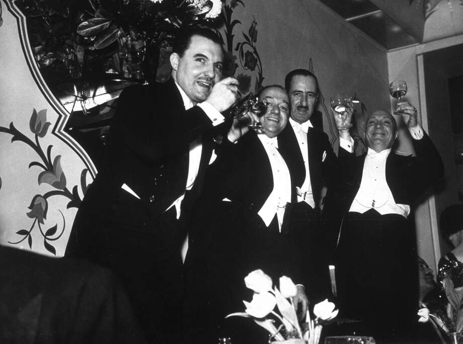 A group of Russian men, toasting in the New Year at a Hungarian restaurant, circa 1937. Photo: Sasha, Getty Images / Hulton Archive