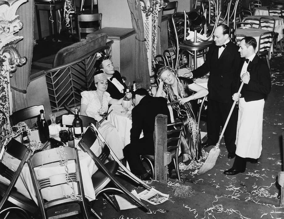 Employees of the Diamond Horseshoe try to clean up after a New Year's Eve party in New York City on Jan. 1, 1940, but there are a few stragglers. Photo: KEYSTONE FRANCE, Getty Images / KEYSTONE FRANCE