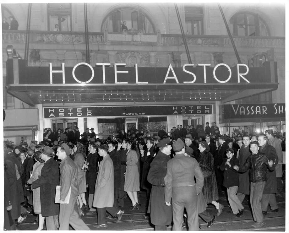 New Year's celebrants walk outside of the Waldorf Astoria on Broadway in New York City, circa 1946. Photo: Archive Photos, Getty Images / 2013 Getty Images