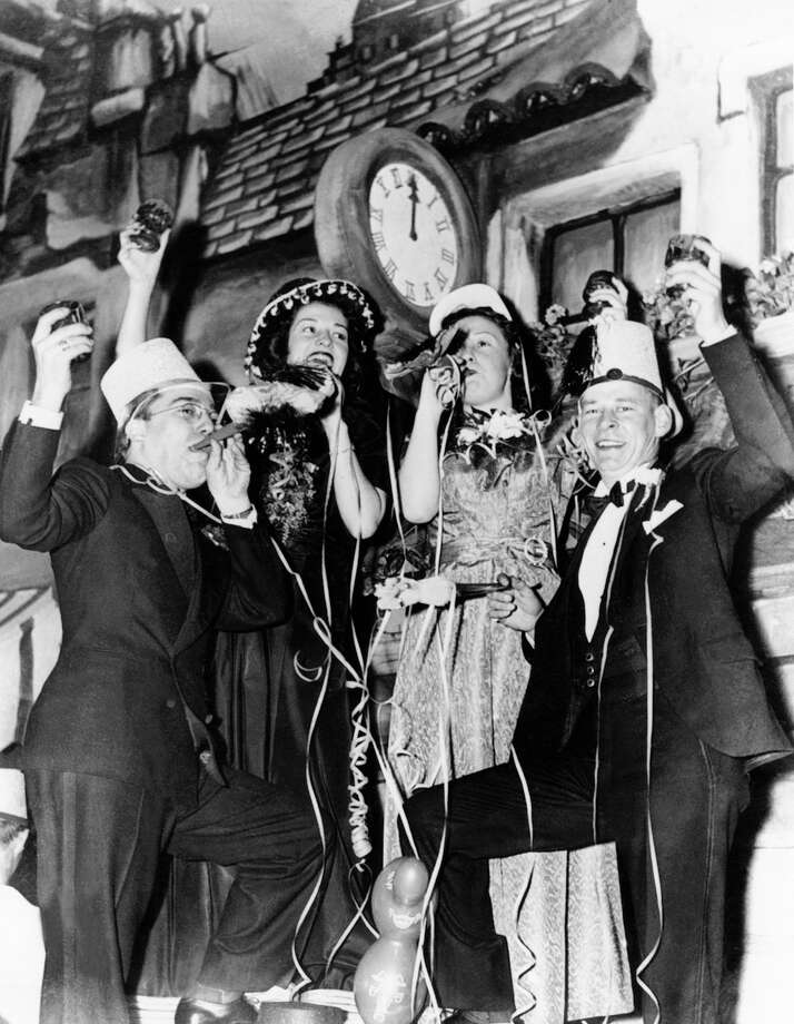 A toast was made upon the first strike of midnight at a New Year's celebration in a New York cabaret on Jan. 1, 1947. Photo: KEYSTONE-FRANCE, Getty Images / KEYSTONE-FRANCE