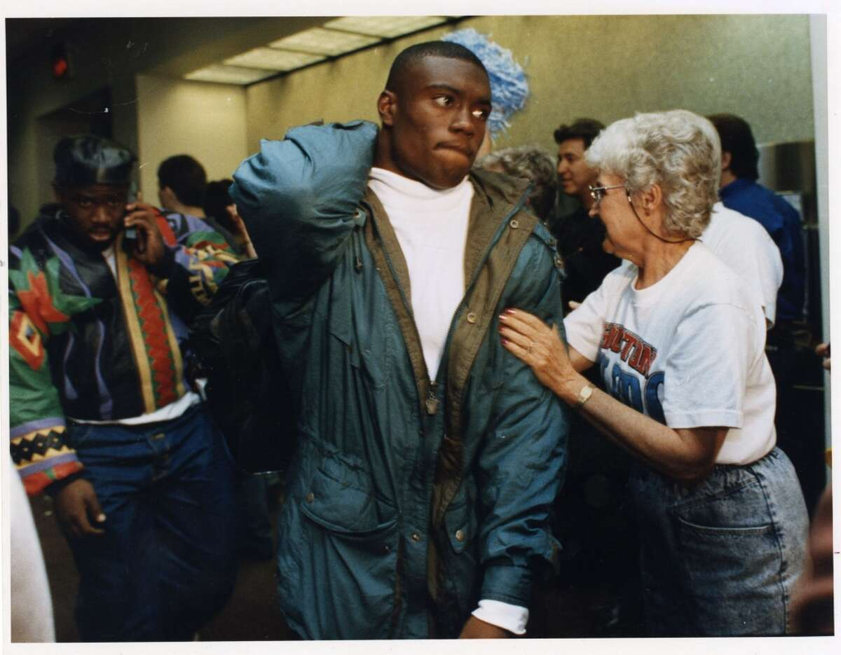 A diehard Oilers fan consoles defensive back Darryll Lewis at Bush Intercontinental Airport after the team returned to Houston after their historic playoff collapse in Buffalo.