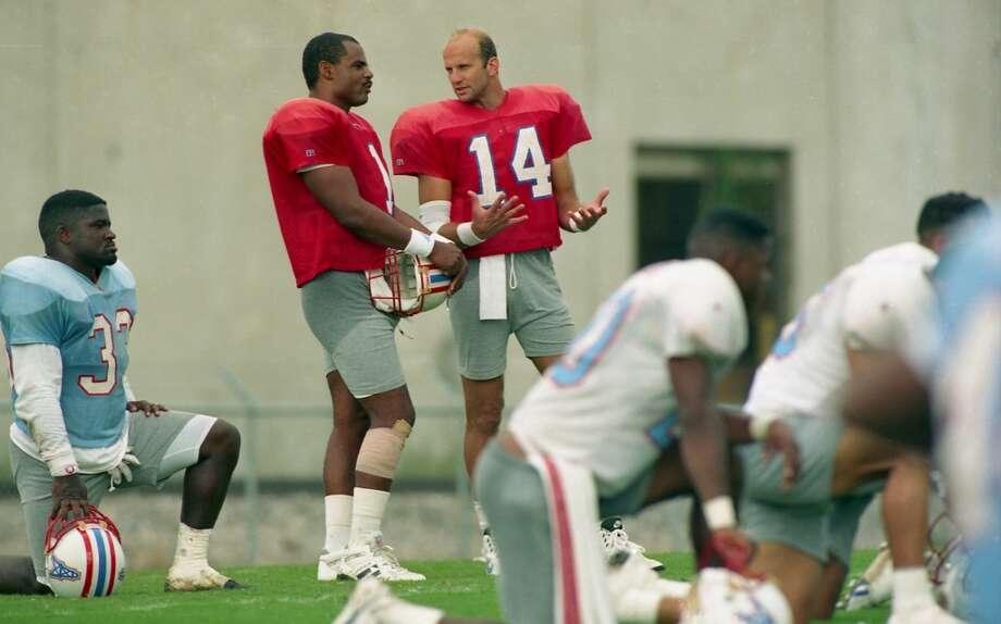 Quarterbacks Warren Moon and Cody Carlson talk during practice. Photo: Anna Marie Remedios, Houston Chronicle