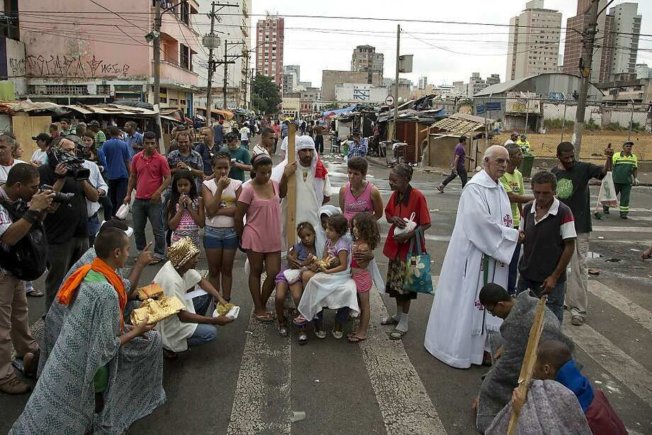 "Church volunteers participate in a live nativity scene in a neighborhood popularly known as ""Crackland"" in downtown Sao Paulo, Brazil, Wednesday, Dec. 25, 2013. Photo: Andre Penner, Associated Press"