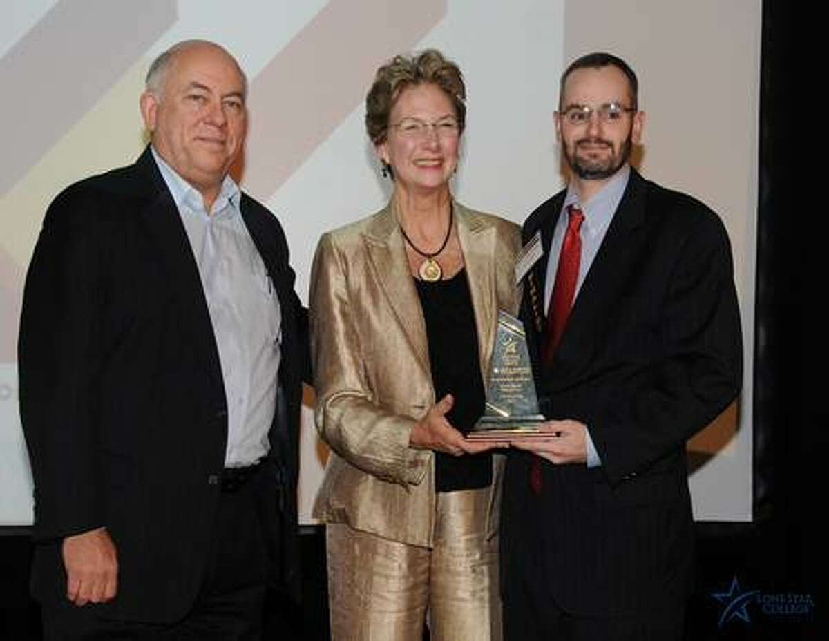 From left, Richard Carpenter, Katherine Persson and Christian Shank celebrate Shank Wealth Management winning the Small Business of the Year Award, Lone Star College Kingwood.