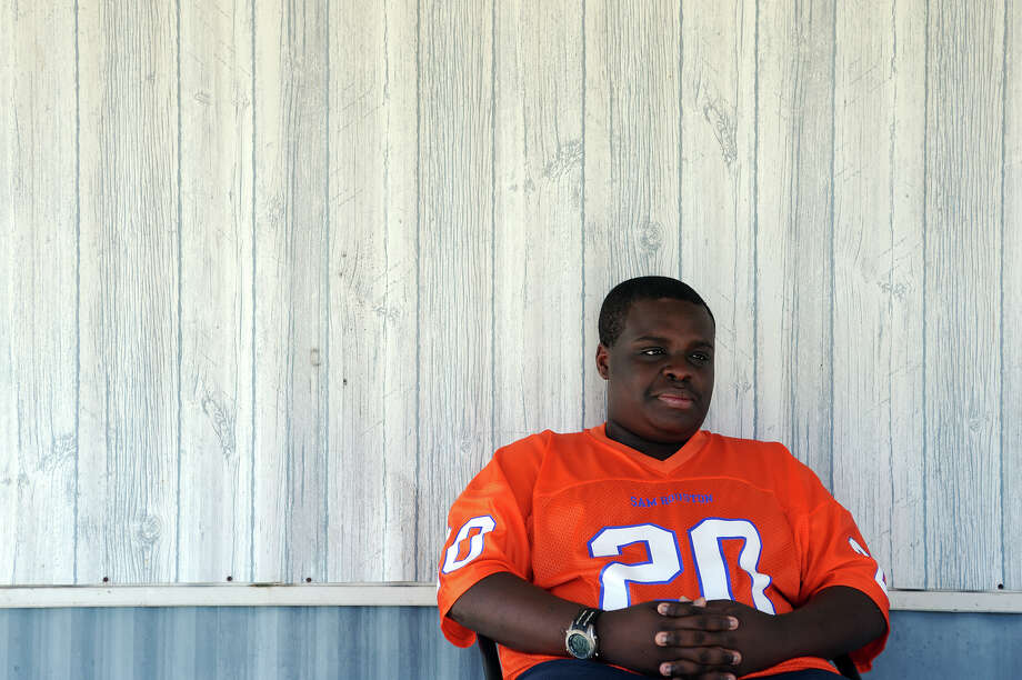 Chris McCain, 16, can recite football scores for multiple leagues from memory. McCain is in the 10th grade at Newton High School and acts as a water boy for the football team. Photo taken Tuesday, 12/24/13 Jake Daniels/@JakeD_in_SETX Photo: Jake Daniels / ©2013 The Beaumont Enterprise/Jake Daniels