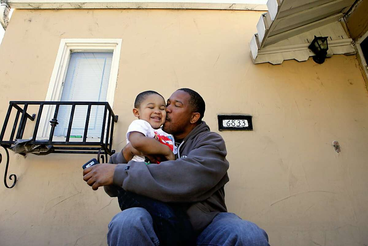 Reverend Ramon Price Sr. kisses his youngest son Ja-Ron, two years old, Thursday March 2, 2012, in Oakland, Calif.  Ramon, who has nine children, lost his son Lamont Price, 17  years old, on February 16 2012 to gun violence in East Oakland, Calif. Photo: Lacy Atkins, The Chronicle