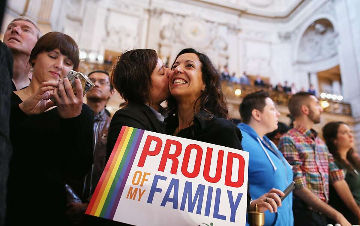 A couple celebrates upon hearing the U.S. Supreme Court's rulings on gay marriage in City Hall June 26, 2013 in San Francisco, United States. The high court struck down DOMA.