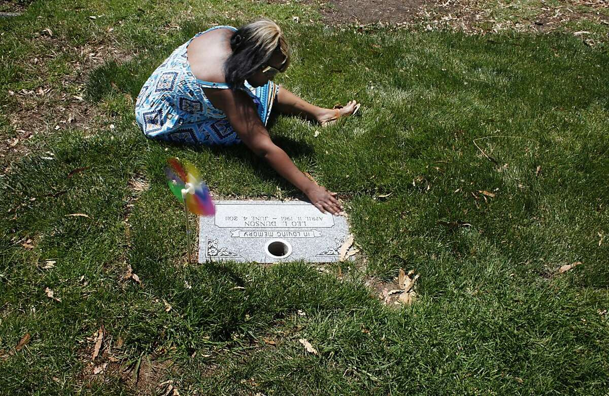 Nicole Hodge visits her stepson, Lamont Price's gravesite on the first birthday since his death, Wednesday July 4, 2012, at  the Rolling Hill Cemetery in Richmond, Calif. Photo: Lacy Atkins, The Chronicle