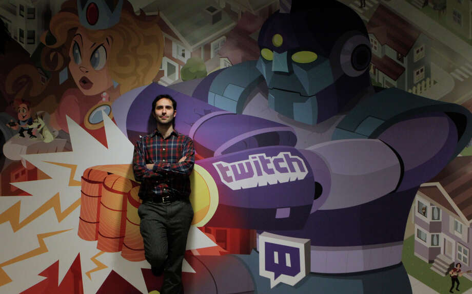 Twitch CEO Emmett Shear stands in front of a mural by artist Justin Orr at the company's S.F. headquarters. Photo: Paul Chinn / The Chronicle / ONLINE_YES