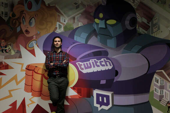 Twitch CEO Emmett Shear stands in front of a mural by artist Justin Orr at the company's S.F. headquarters.