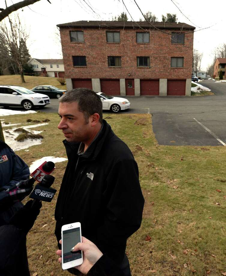 Bethlehem Police Lt. Tom Heffernan Jr. briefs the media after a body of a woman was found Thursday Dec. 26, 2013, immediately behind him in the parking area of an apartment complex in Glenmont, N.Y.      (Skip Dickstein / Times Union) Photo: SKIP DICKSTEIN