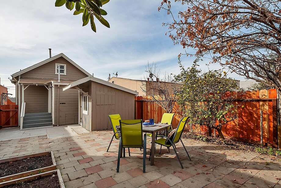The backyard of 3944 Penniman Ave. in Oakland includes a trio of raised planting beds and a detached building that can serve as a workshop or home office. Photo: Tom Taylor/Taylor Photography