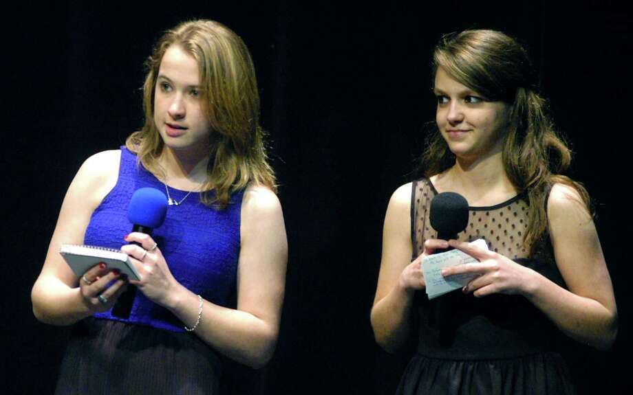 Co-hosts Brianna Walker, left, and Rachel Schaefer welcome the crowd to New Milford High School students' May 19, 2013 performances for the benefit of families of Sandy Hook Elementary School in Newtown. Photo: Norm Cummings / The News-Times