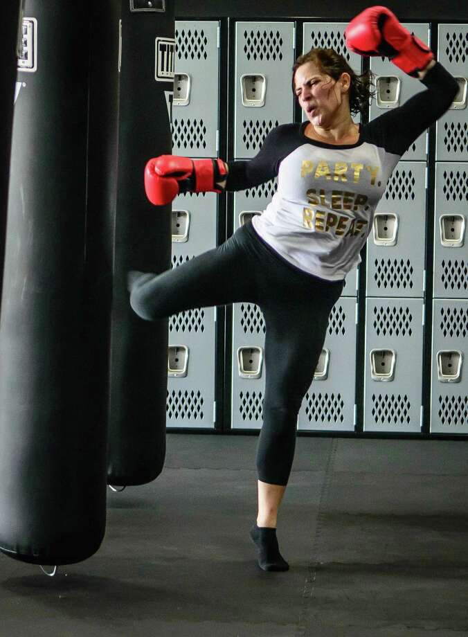 Jennifer Granger sweats it out during her kickboxing workout. Photo: ÂKim Christensen, Photographer / ©Kim Christensen