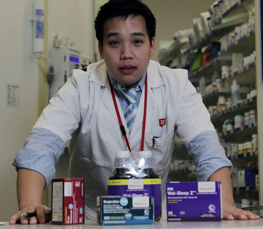 Walgreen's pharmacist David Tran suggests patients contact their pharmacists for a medication review, in which prescriptions are reviewed for potential problems. Photo: James Nielsen, Staff / © 2013  Houston Chronicle