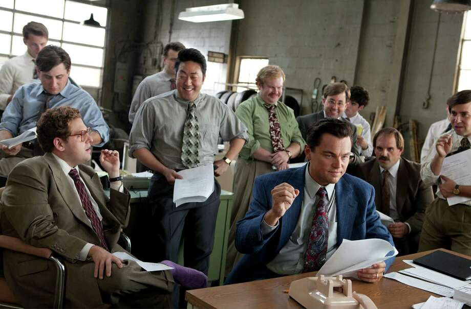 "In an undated handout photo, Leonardo DiCaprio, center, in the film ""The Wolf of Wall Street,"" released by Paramount Pictures. Studios used to crave the largest market share, or percentage of ticket sales, but profitability is the new mantra as many like Paramount produce fewer films at higher profit margins. From left: : Jonah Hill, Kenneth Choi, Henry Zebrowski, DiCaprio, P.J. Byrne and Ethan Suplee. (Mary Cybulski/Paramount Pictures via The New York Times) -- NO SALES; FOR EDITORIAL USE ONLY WITH STORY SLUGGED PARAMOUNT STRATEGY BY MICHAEL CIEPLY and BROOKS BARNES. ALL OTHER USE PROHIBITED. ORG XMIT: XNYT48 Photo: MARY CYBULSKI / © 2013 Paramount Pictures.  All Rights Reserved."