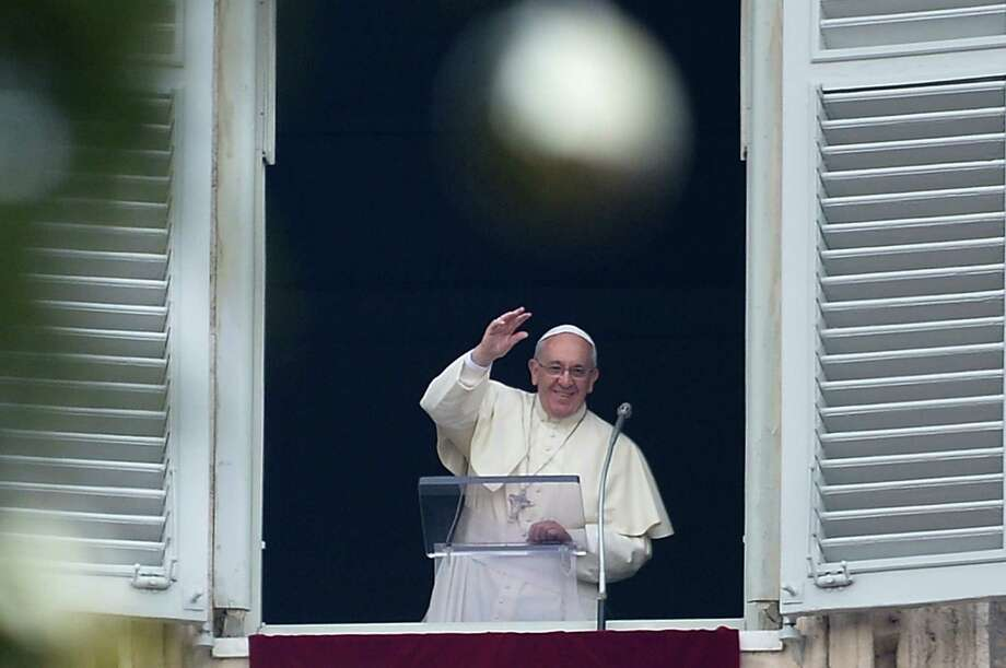 Pope Francis addresses the crowd from his private apartment during his Sunday prayer at the Vatican's St. Peter's Square on Dec. 22. Photo: Alberto Pizzoli / AFP/ Getty Images / AFP