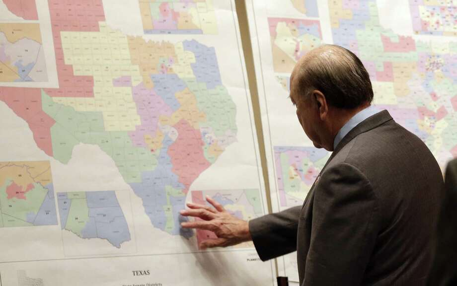 State Sen. Juan Hinojosa looks at voting district maps. The U.S. high court gave mixed rulings on the Voting Rights Act. Photo: Associated Press File Photo / AP