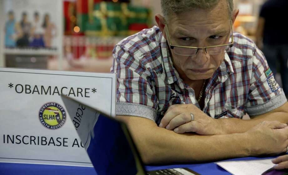 Angel Rivera tries to sign up for a health plan under the Affordable Care Act at a kiosk in a Miami mall. The Obama administration has a lot to be embarrassed about with the ACA. Photo: Joe Raedle / Getty Images / 2013 Getty Images