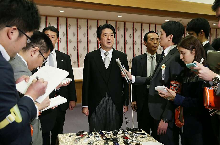 Japanese Prime Minister Shinzo Abe speaks to reporters during his visit to the Yasukuni shrine. Photo: Jiji Press, AFP/Getty Images