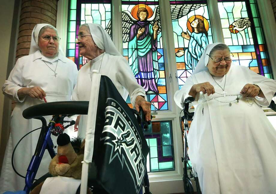 Bob Owen loves this candid moment with the Salesian Sisters, Sister Guadalupe Medina (from left), Sister Rosalba Garcia and Sister Angelita Guzman. / © 2012 San Antonio Express-News