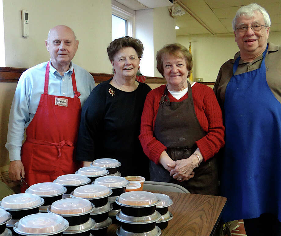 Besides cookies, parishioners prepared Hungarian meals to go at St. Emery's Christmas Cookie Walk Festival event last weekend. Pictured here are Gregory and Barbara Chuga, Mary Ann and Art Corcoran. Photo: Mike Lauterborn / Fairfield Citizen contributed