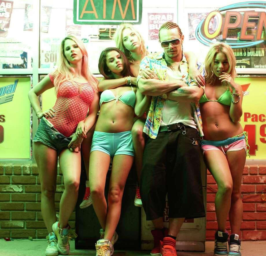 "Rachel Korine (from left), Selena Gomez, Ashley Benson, James Franco and Vanessa Hudgens star in ""Spring Breakers."" Photo: Courtesy Photo / MCT"