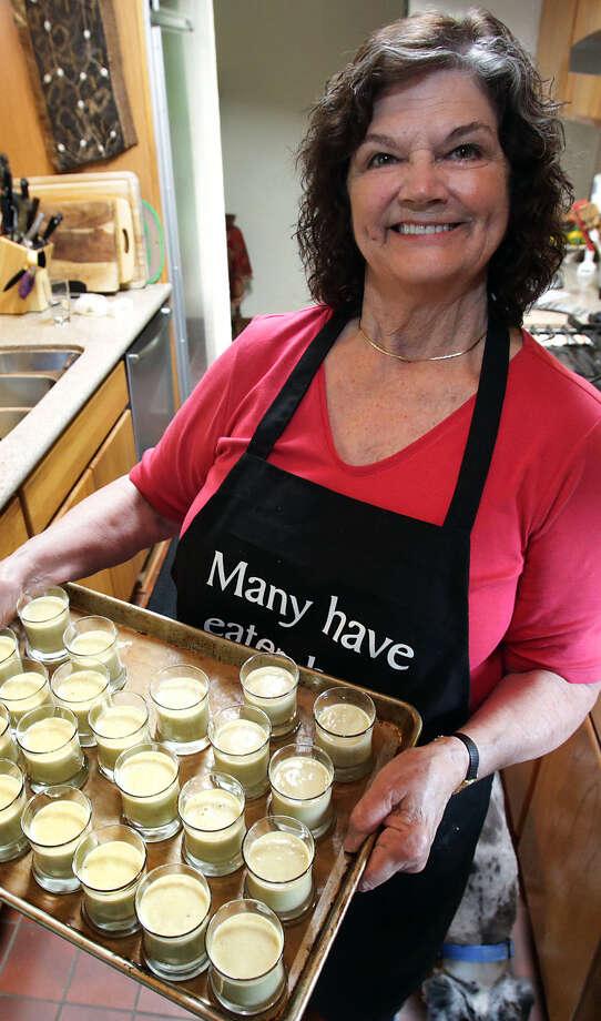 Marianne Anderson prepares individual banana custard desserts in her kitchen. / © 2012 San Antonio Express-News
