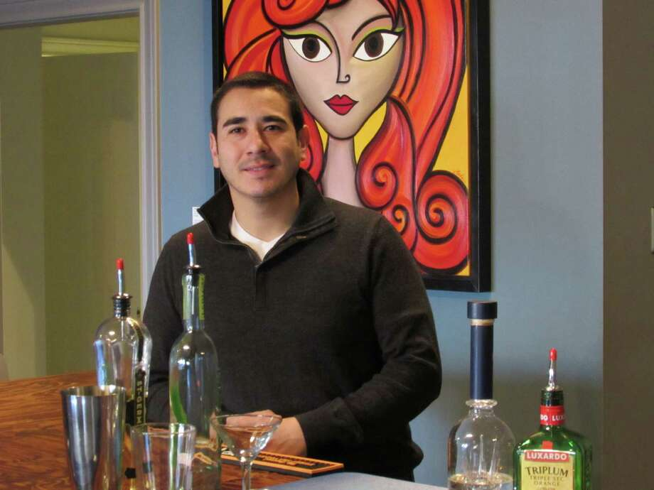 Marco Guerrero is the owner of Gustology, where patrons learn how to mix drinks. Photo: Burt Henry / San Antonio Express-News