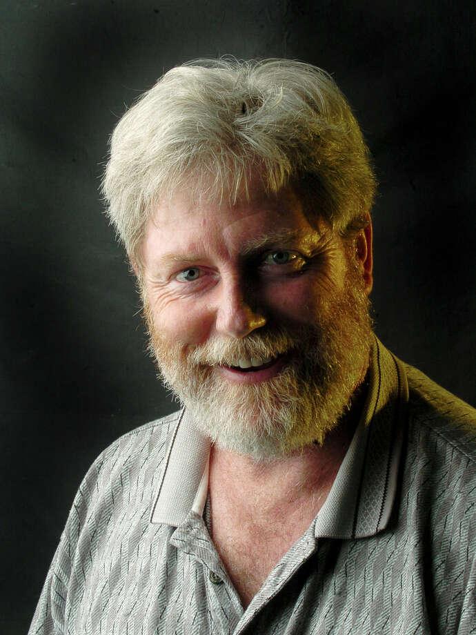Tom Reel, photojournalist Photo: BILLY CALZADA, Express-News / SAN ANTONIO EXPRESS-NEWS