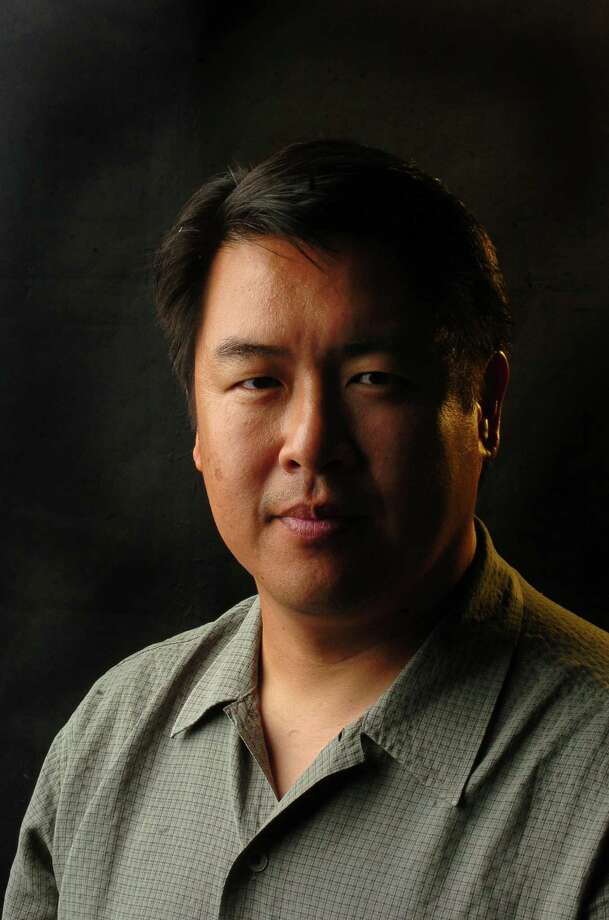 Kin Man Hui, staff photographer Photo: BILLY CALZADA, Express-News / SAN ANTONIO EXPRESS-NEWS