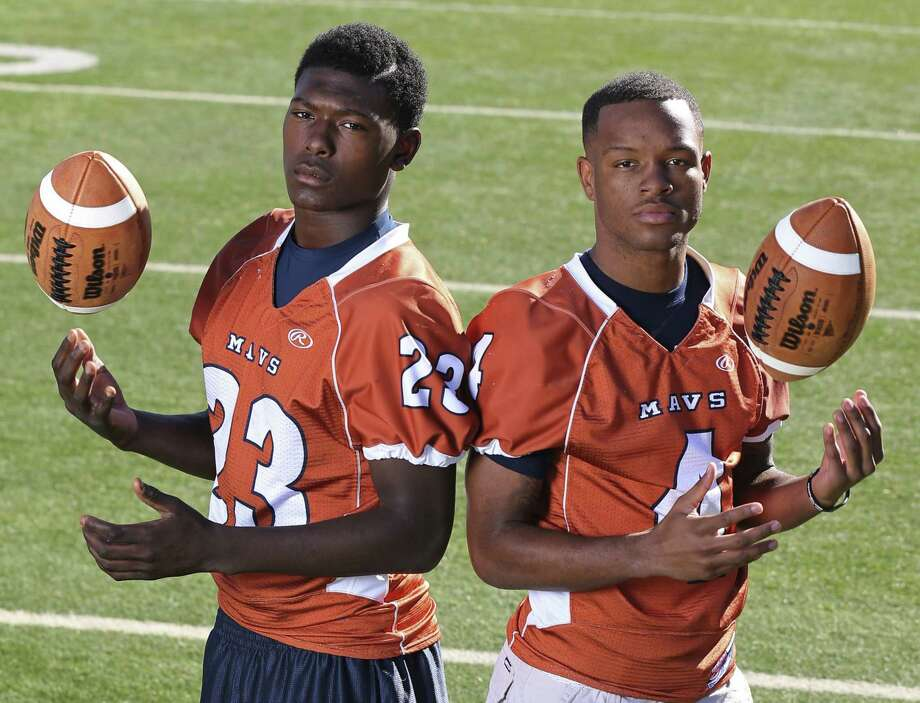 From left: Ja'Michael Brown of Madison and Byron Daniels of Madison. Not pictured: Dimitri Flowers of Churchill.  Click the link below to see the rest of the First Team. / © 2013 San Antonio Express-News