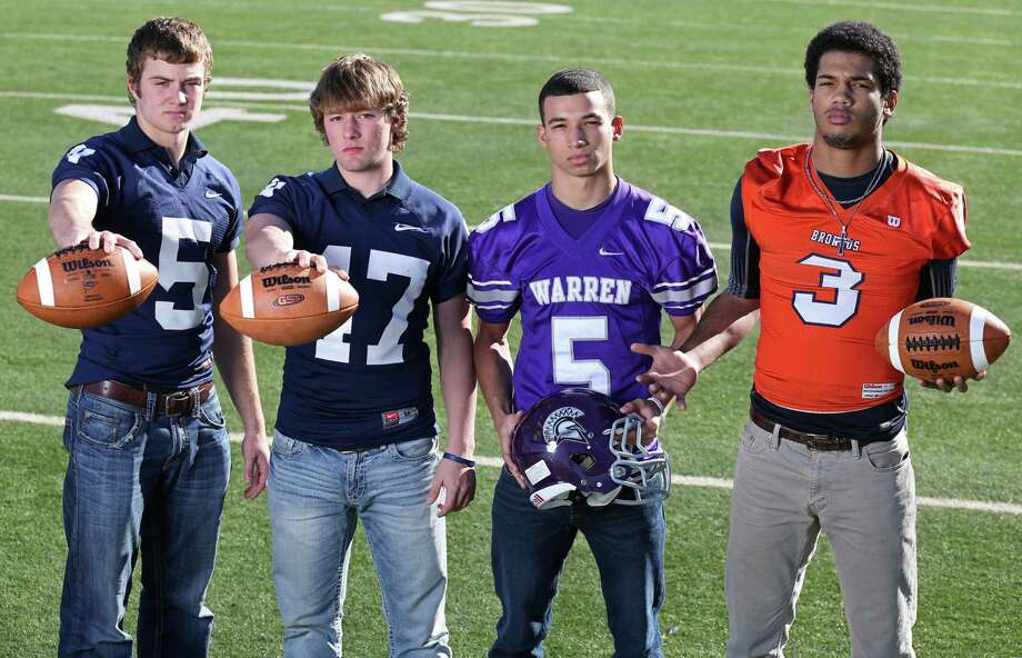 From left: Joseph Barsalou of Smithson Valley, Aaron Kennedy of Smithson Valley, Sean Eddington of Warren, Jonathan Robinson of Brandeis. Click the link below to see the rest of the First Team. Photo: San Antonio Express-News / © 2013 San Antonio Express-News