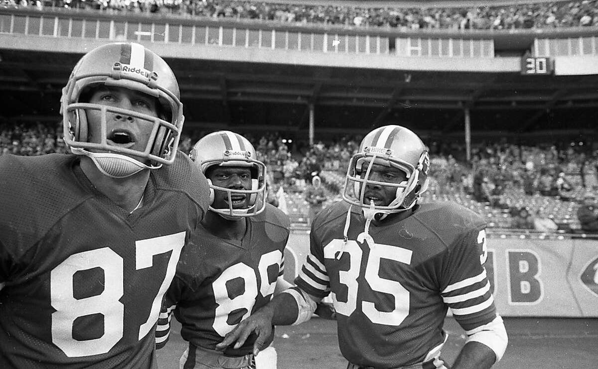 49ers #87 Dwight Clark, #89 James Owens and #35 Lenvil Elliott react during the end of the game against the Saints December 7, 1980.